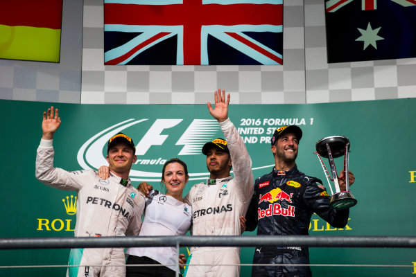 Circuit of the Americas, Austin Texas, USA. Sunday 23 October 2016. Nico Rosberg, Mercedes AMG, 2nd Position, Victoria Vowles, Partner Services Director, Mercedes AMG, Lewis Hamilton, Mercedes AMG, 1st Position, and Daniel Ricciardo, Red Bull Racing, 3rd Position, on the podium. World Copyright: Sam Bloxham/LAT Photographic ref: Digital Image _SLA2660_1