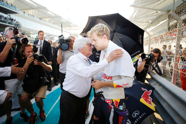 Yas Marina Circuit, Abu Dhabi, United Arab Emirates. Sunday 3rd November 2013. Sebastian Vettel, Red Bull Racing, with Bernie Ecclestone, CEO and President, FOM, on the grid. World Copyright: Steven Tee/LAT Photographic. ref: Digital Image _L0U0321
