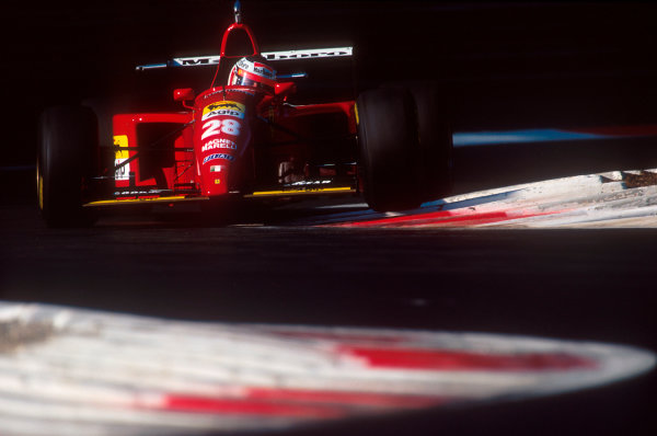 Monza, Italy.8-10 September 1995.Gerhard Berger (Ferrari 412T2). Alesi's rear wing camera  fell off, straight into his rear suspension at speed, causing him to exit the race. Ref-95 ITA 09.World Copyright - LAT Photographic