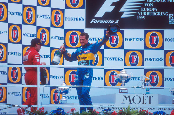 Nurburgring, Germany.29/9-1/10 1995.Michael Schumacher (Benetton Renault) celebrates 1st position on the podium.  Jean Alesi (Ferrari) 2nd position next to him.Ref-95 EUR 03.World Copyright - LAT Photographic