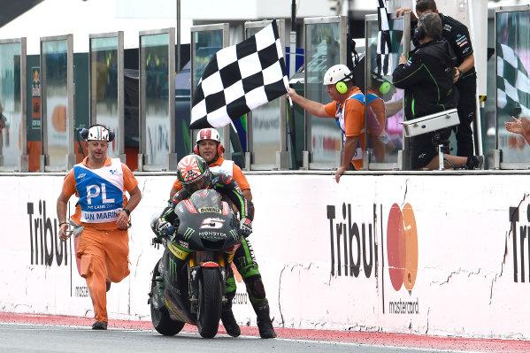 2017 MotoGP Championship - Round 13 Misano, Italy. Sunday 10 September 2017 Johann Zarco, Monster Yamaha Tech 3 pushes his bike over the finish line World Copyright: Gold and Goose / LAT Images ref: Digital Image 692000
