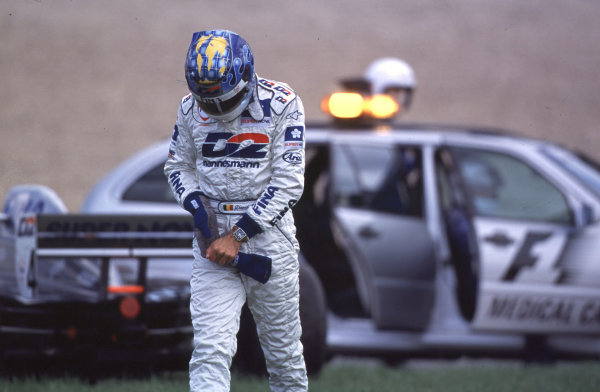 International Formula 3000 Championship Nurburgring, Germany. 19th - 20th May 2000 Pole sitter David Saelens walks away from his stricken car after crashing out of the race World - Bellanca/LAT Photographic