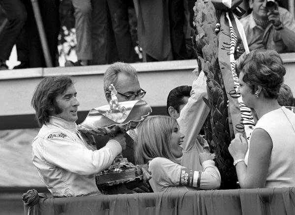 Winner Jackie Stewart (GBR) Matra celebrates his victory and first World Championship with wife Helen (centre).