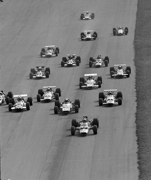 The start, Pole sitter Jochen Rindt(AUT) Lotus 49B gets away ahead of Jackie Stewart(GBR), and Piers Courage(GBR) and Denny Hulme(NZL) Italian GP, Monza, 8 September 1969