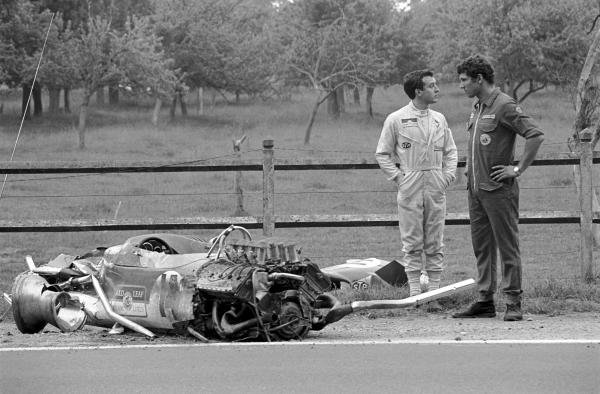 Jackie Oliver (GBR) (left) and a Lotus mechanic wonder how Jackie was able to walk away from the Lotus 49B after a violent accident in practice.   French Grand Prix, Rouen-les-Essarts, 7 July 1968.