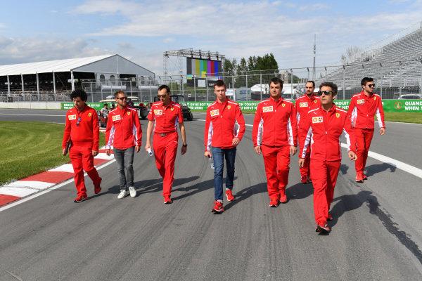 Sebastian Vettel (GER) Ferrari and Daniil Kvyat (RUS) Ferrari walk the track