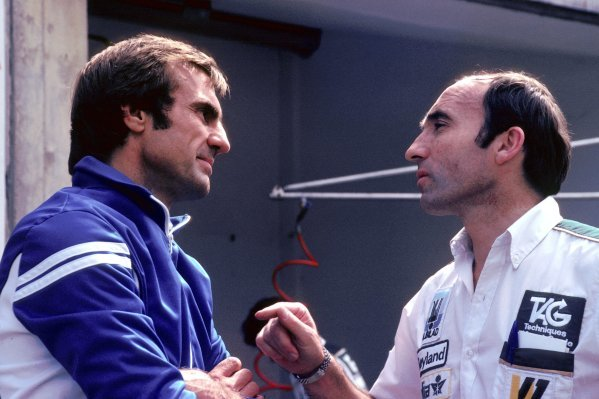 (L to R): Carlos Reutemann (ARG) Williams talks with Frank Williams (GBR) Williams Team Owner. 1980 Formula One World Championship.