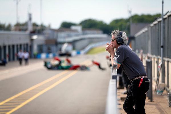 FIA Formula E Season 3 Testing - Day Two. Donington Park Racecourse, Derby, United Kingdom. A Jaguar Racing team member on the pit wall. Wednesday 24 August 2016. Photo: Adam Warner / LAT / FE. ref: Digital Image _L5R0763