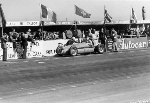 "1950 British Grand Prix.Silverstone, Great Britain. 13th May 1950.""B Bira"" (Maserati 4CLT/48) retires in the pits.World Copyright: LAT Photographicref: 3734I/23"
