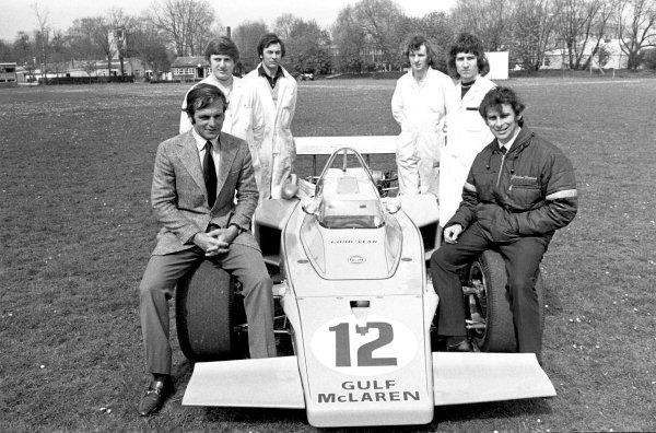 1970s Indycar Racing.Peter Revson and designer Gordon Coppuck pose with the McLaren M16.World Copyright: LAT Photographicref: b&w print