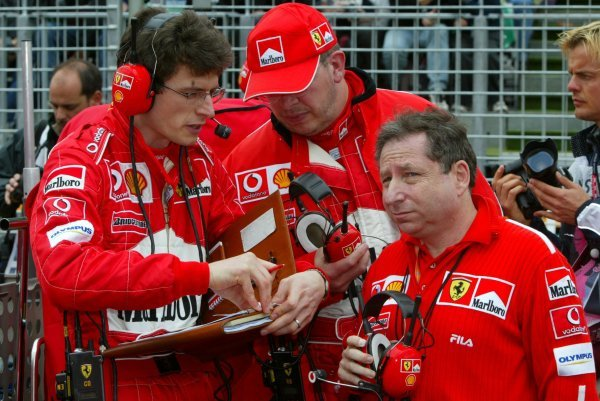 (L to R): A Ferrari mechanic; Ross Brawn (GBR) Ferrari Technical Director and Jean Todt (FRA) Ferrari General Manager on the grid.