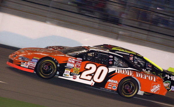 Sixth placed Tony Stewart (USA) Jo Gibbs Racing Home Depot Pontiac (No.20) battles with Joe Nemechek (USA) Hendrick Motorsports UAW Delphi Chevrolet.