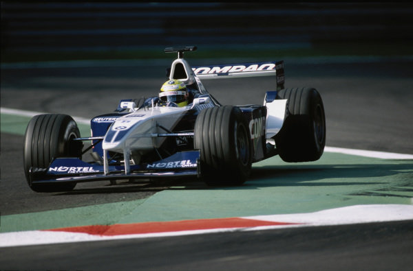 Ralf Schumacher, Williams FW23 BMW, misses an apex to a chicane and bounces over the kerbs.