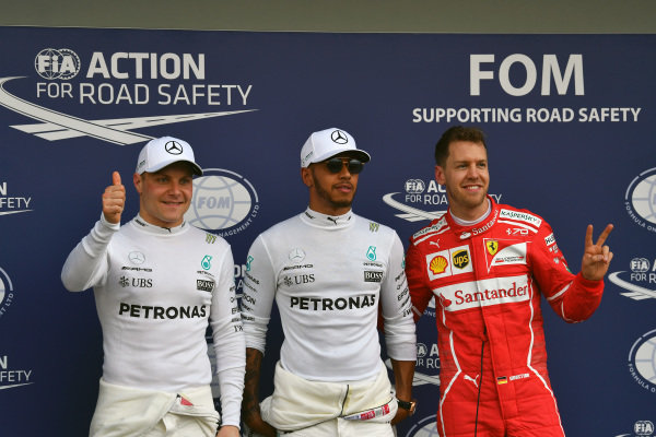(L to R): Valtteri Bottas (FIN) Mercedes AMG F1, pole sitter Lewis Hamilton (GBR) Mercedes AMG F1 and Sebastian Vettel (GER) Ferrari celebrate in parc ferme at Formula One World Championship, Rd1, Australian Grand Prix, Qualifying, Albert Park, Melbourne, Australia, Saturday 25 March 2017.