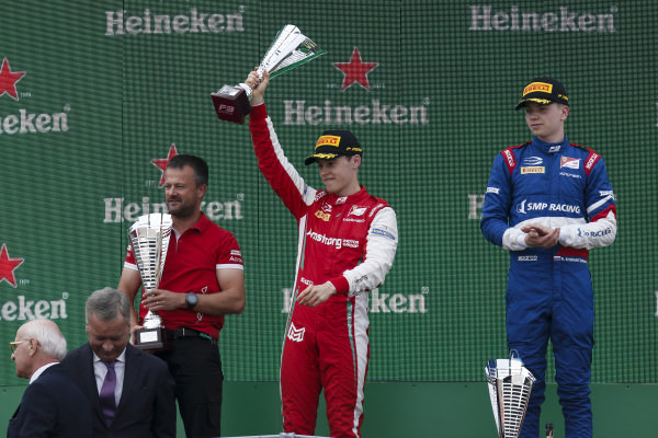 AUTODROMO NAZIONALE MONZA, ITALY - SEPTEMBER 07: Marcus Armstrong (NZL) PREMA Racing, Race winner Robert Shwartzman (RUS) PREMA Racing on the podium during the Monza at Autodromo Nazionale Monza on September 07, 2019 in Autodromo Nazionale Monza, Italy. (Photo by Joe Portlock / LAT Images / FIA F3 Championship)
