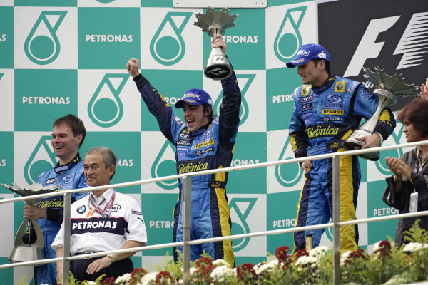 Fernando Alonso celebrates 2nd place on the podium with teammate and winner Giancarlo Fisichella and race engineer Alan Permane.