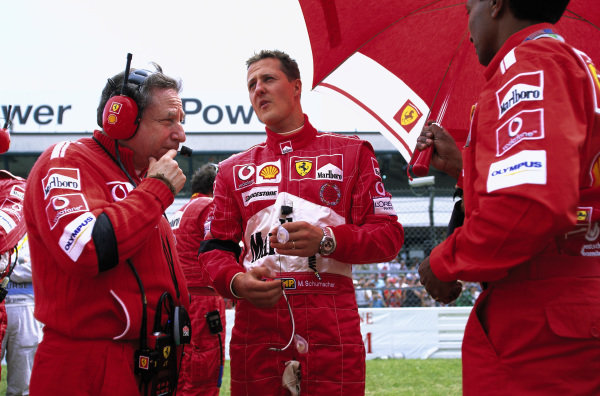 Michael Schumacher talks with Jean Todt on the grid.