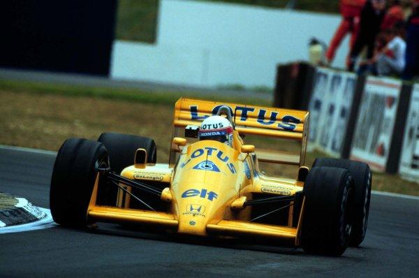 1987 British Grand Prix.Silverstone, England.10-12 July 1987.Saturo Nakajima (Lotus 99T Honda) 4th position.World Copyright - LAT Photographic