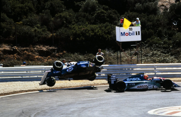 Damon Hill, Williams FW16B Renault, gets airborne after contact with Eddie Irvine, Jordan 194 Hart.