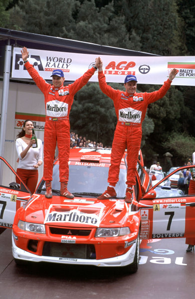 2001 World Rally Championship. Rally Portugal, Portugal. 8th-11th March 2001. Tommi Makinen and Risto Mannisenmaki celebrate their win - podium. World Copyright: McKlein / LAT Photographic. Ref: Portugal A01
