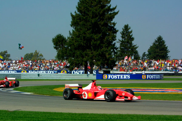 2002 American Grand Prix.Indianapolis, Indiana, USA. 27-29 September 2002.Michael Schumacher followed by Rubens Barrichello (both Ferrari F2002's). They finished in 2nd and 1st positions respectively.World Copyright - LAT Photographicref: Digital File Only