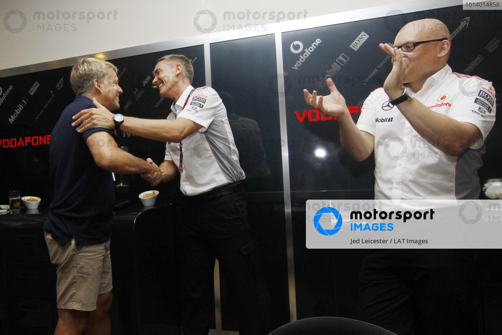 Marina Bay Circuit, Singapore. Saturday 21st September 2013. LAT Chief Photographer Steven Tee is greeted by Martin Whitmarsh, Team Principal, McLaren at the McLaren hospitality area during a surprise celebration of his 500th Grand Prix. World Copyright: Jed Leicester/LAT Photographic. ref: Digital Image _JED2662