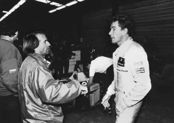 1989 Williams FW12C Renault Testing. Paul Ricard, France. Jacques Laffite with James Hunt in the garage during the test of a Williams FW12C Renault, portrait.  World Copyright: LAT Photographic.  Ref:  B/W Print.