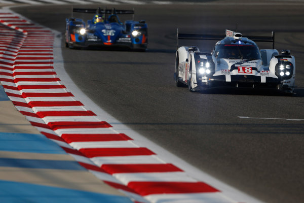 2015 FIA World Endurance Championship Bahrain 6-Hours Bahrain International Circuit, Bahrain Saturday 21 November 2015. Romain Dumas, Neel Jani, Marc Lieb (#18 LMP1 Porsche AG Porsche 919 Hybrid) leads Nelson Panciatici, Paul Loup Chatin, Tom Dillmann (#36 LMP2 Signatech Alpine Alpine A450B Nissan). World Copyright: Alastair Staley/LAT Photographic ref: Digital Image _79P0592