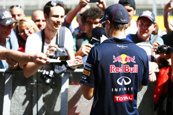 Circuit de Catalunya, Barcelona, Spain. Thursday 8 May 2014. Sebastian Vettel, Red Bull Racing, signs autographs for fans. World Copyright: Andy Hone/LAT Photographic. ref: Digital Image _ONY7633