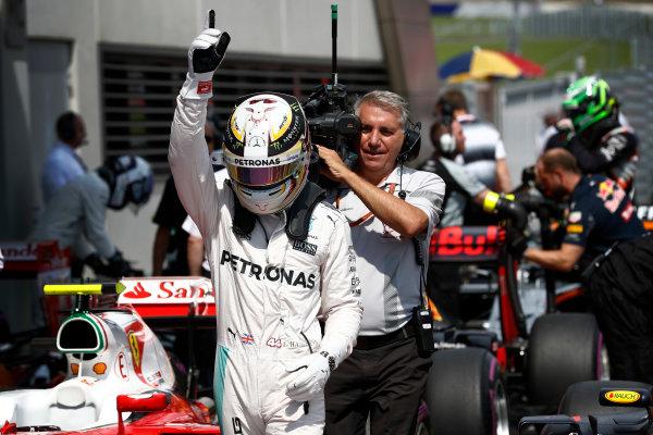 Red Bull Ring, Spielberg, Austria. Saturday 02 July 2016. Lewis Hamilton, Mercedes AMG celebrates after taking Pole Position. World Copyright: Glenn Dunbar/LAT Photographic ref: Digital Image _V2I2943