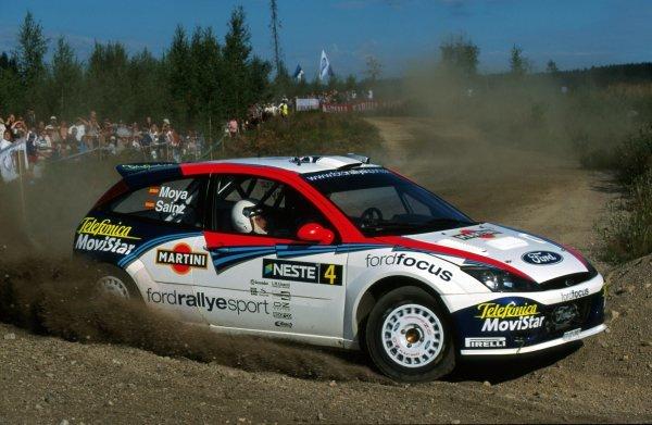 Carlos Sainz (ESP) and Luis Moya (ESP), Ford Focus RS WRC.FIA World Rally Championship, Rd9, Neste Rally Finland, Finland. 8-11 August 2002.BEST IMAGE