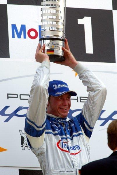 Frank Stippler (GER) Infineon - Team Farnbacher on the podium.Porsche Supercup, Rd8, Hockenheim, Germany,3 August 2003.DIGITAL IMAGE