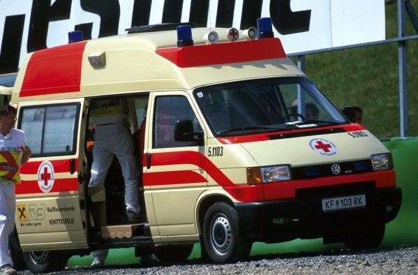 Takuma Sato (JPN) Jordan Honda is loaded into the Ambulance to be taken to the medical centre. Formula One World Championship, Rd6, Austrian Grand Prix, A1-Ring, Austria. 12 May 2002.BEST IMAGE