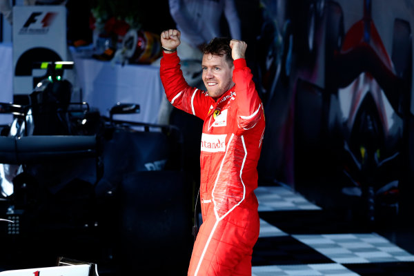 Albert Park, Melbourne, Australia. Sunday 26 March 2017. Sebastian Vettel, Ferrari SF70H, 1st Position, celebrates on arrival in Parc Ferme.  World Copyright: Glenn Dunbar/LAT Images Ref: Digital Image _X4I3740