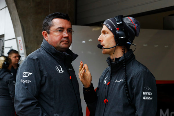 Shanghai International Circuit, Shanghai, China.  Friday 07 April 2017. Eric Boullier, Racing Director, McLaren, waits with a colleague during a weather delay in FP2. World Copyright: Steven Tee/LAT Images ref: Digital Image _R3I2445