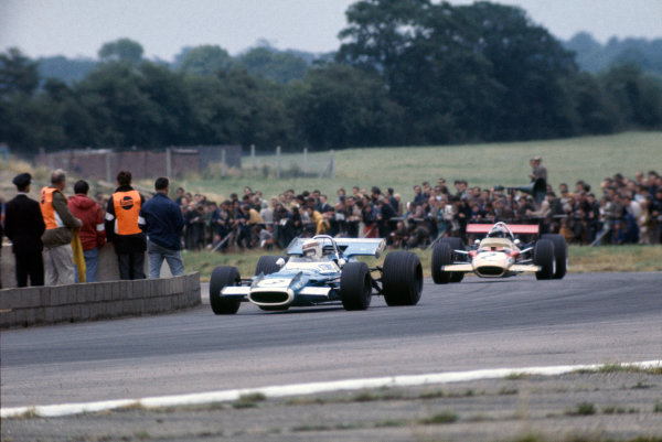 Silverstone, Great Britain. 19th July 1969.Jackie Stewart (Matra MS80-Ford), 1st position, leads Jochen Rindt, (Lotus 49B-Ford), 4th position, action.World Copyright: LAT Photographic.Ref: Colour Transparency.