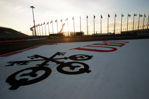 Sochi Autodrom, Sochi, Russia. Sunday 12 October 2014. The sun sets on the track. World Copyright: Charles Coates/LAT Photographic. ref: Digital Image _N7T7197