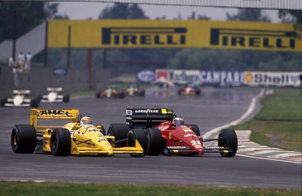 Gerhard Berger (AUT) Ferrari F187, 3rd place, passes Satoru Nakajima (JPN) Lotus 100T, DNF