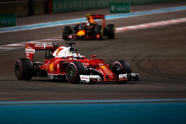 Yas Marina Circuit, Abu Dhabi, United Arab Emirates. Sunday 27 November 2016. Sebastian Vettel, Ferrari SF16-H, leads Max Verstappen, Red Bull Racing RB12 TAG Heuer. World Copyright: Sam Bloxham/LAT Photographic ref: Digital Image _SLA9690