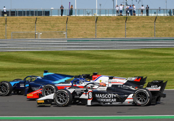 Roy Nissany (ISR, DAMS), and Christian Lundgaard (DNK, ART Grand Prix), pass as Robert Shwartzman (RUS, Prema Racing), recovers from a spin
