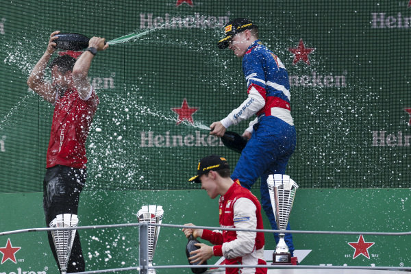 AUTODROMO NAZIONALE MONZA, ITALY - SEPTEMBER 07: Marcus Armstrong (NZL) PREMA Racing, Race winner Robert Shwartzman (RUS) PREMA Racing on the podium with the champagne during the Monza at Autodromo Nazionale Monza on September 07, 2019 in Autodromo Nazionale Monza, Italy. (Photo by Joe Portlock / LAT Images / FIA F3 Championship)