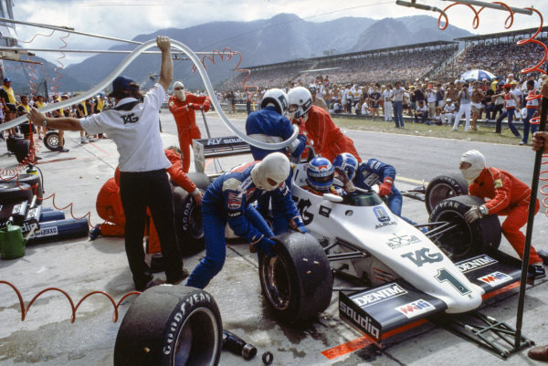 Keke Rosberg, Williams FW08C Ford, about to suffer a disastrous pitstop, where a small amount of spilt fuel caused a flash-fire, which was promptly extinguished by marshals. He returned to his cockpit to finish 2nd but was disqualified for a push start after this stop.