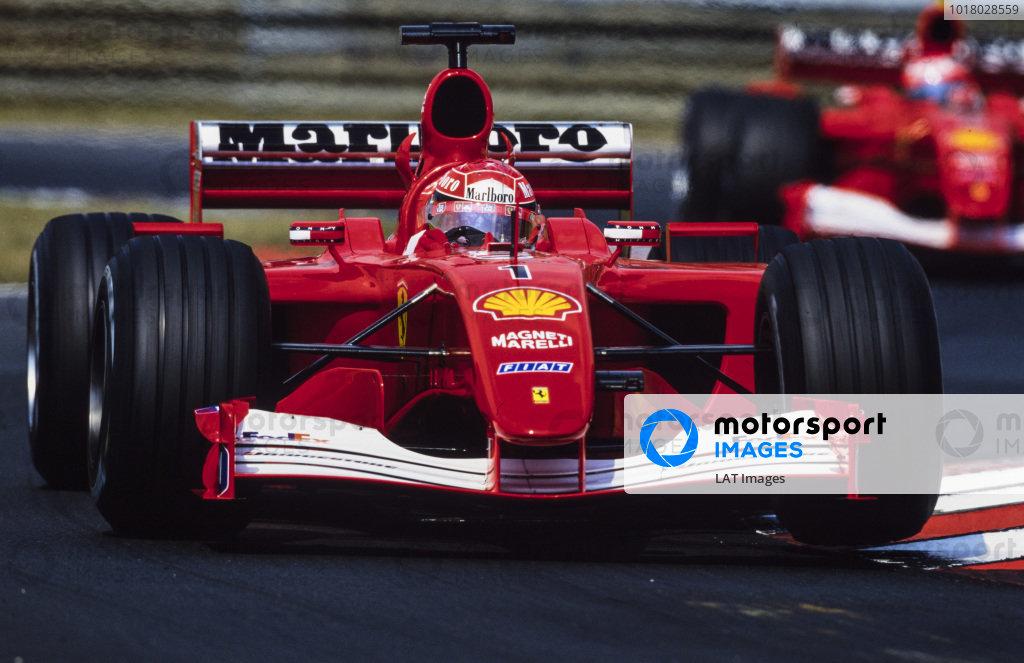 Michael Schumacher, Ferrari F2001, leads Rubens Barrichello, Ferrari F2001.