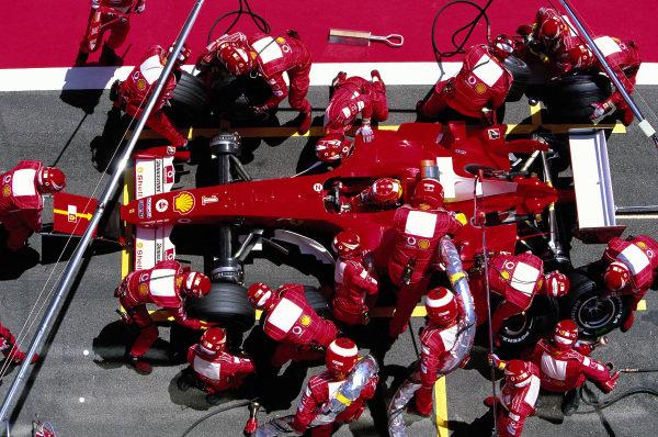 A pit stop for Michael Schumacher, Ferrari F2004.