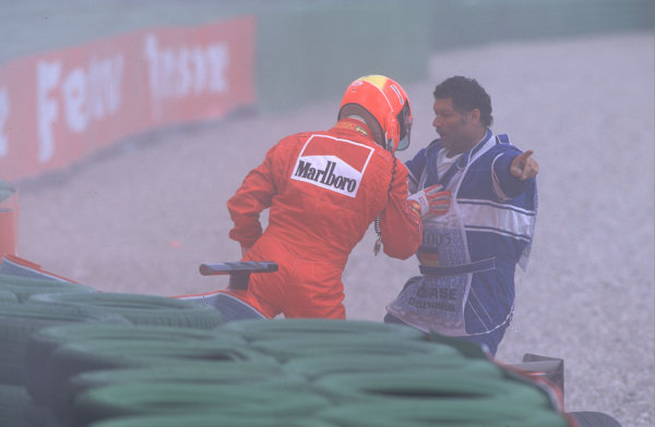 2000 German Grand Prix.Hockenheim, Germany.28-30 July 2000.Michael Schumacher (Ferrari) steps out of his car after he had pulled across into Giancarlo Fisichella (Benetton B200 Playlife) on the approach to the Nordkurve at the start, resulting in a crash.World Copyright - Coates/LAT Photographiccrash sequence 09.ref: 35mm A09