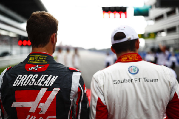 Romain Grosjean, Haas F1 Team, and Charles Leclerc, Sauber, on the grid for the national anthem