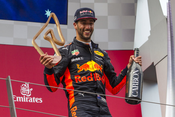 Daniel Ricciardo (AUS) Red Bull Racing celebrates on the podium with the champagne and the trophy at Formula One World Championship, Rd9, Austrian Grand Prix, Race, Spielberg, Austria, Sunday 9 July 2017.