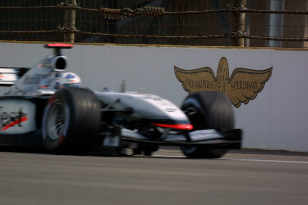 2002 American Grand Prix - Friday PracticeIndianapolis, USA. 27th September 2002David Coulthard passes the Indianapolis Motor Speedway logo.World Copyright - LAT Photographicref: Digital File Only