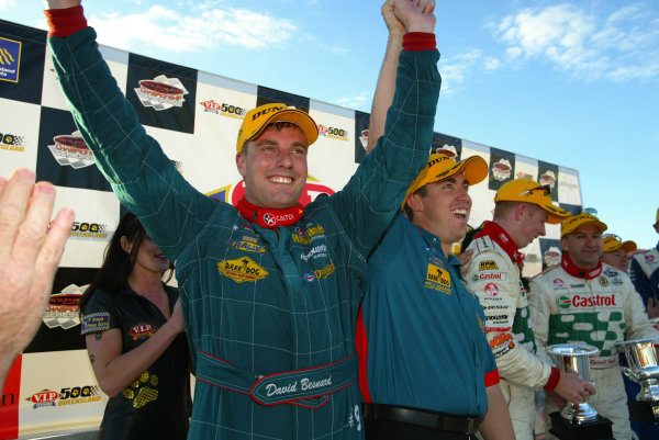2002 Australian V8 Supercar Championship R9 QLD 500 Queensland, Australia 15th September 2002Ford driver David Besnard and C0 driver Simon Wills on the podium after winning the QLD 500. Besnard took the lead on the last lap when race leader Greg Murphy's car ran out of fuelWorld Copyright - Mark Horsburgh/LAT Photographicref: Digital File Only