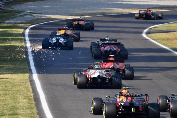 Sparks trail from Pierre Gasly, AlphaTauri AT02 after damage on the opening lap